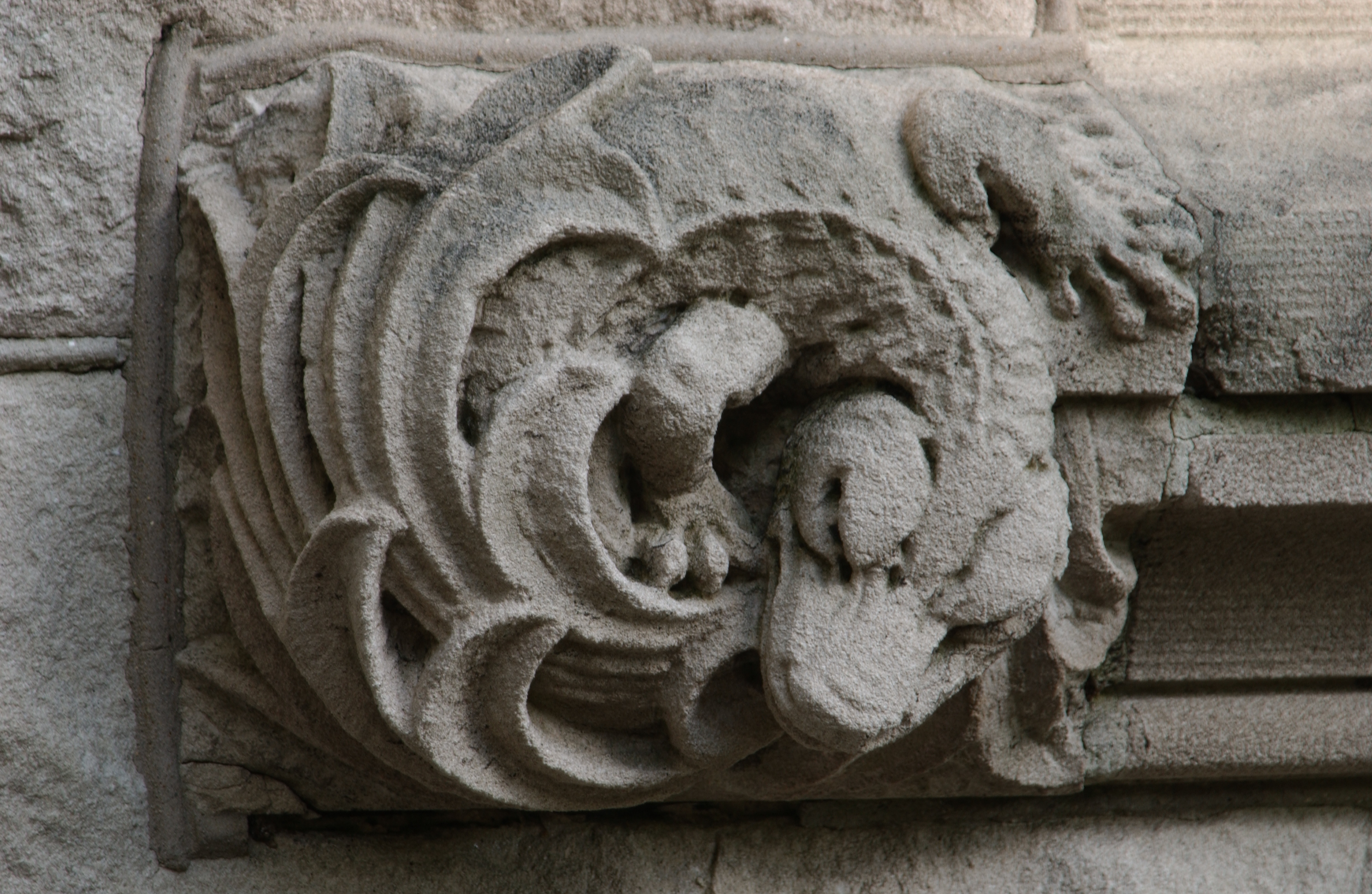 Close-up Photo of Dragon on Tulane University's Tilton Hall - The Murphy Institute