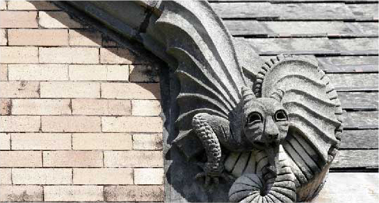 Gargoyle on Roof of Building on Tulane University Campus - The Murphy Institute