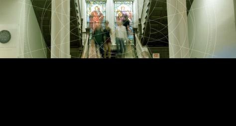 Blurred Photo of Students Walking in Stairwell - The Murphy Institute
