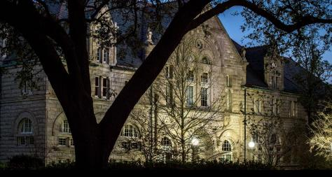 Photo of Tilton Hall Behind Tree At Night - The Murphy Institute