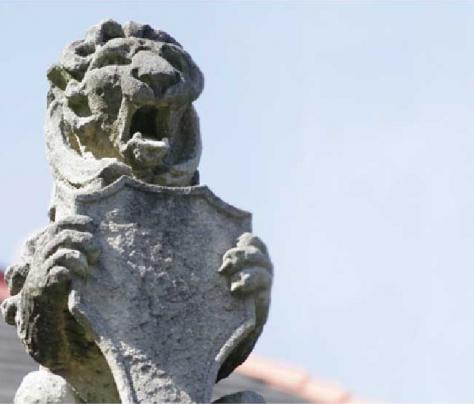 Statue of Lion Holding Tulane Shield - The Murphy Institute